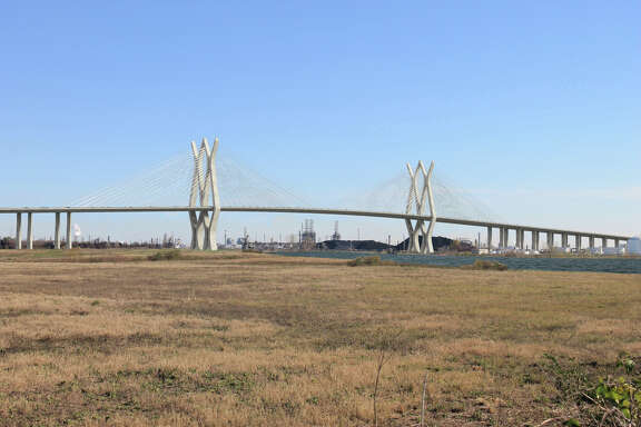 Harris County Toll Road Authority is planning a $1 billion replacement of the Sam Houston Tollway bridge spanning the Houston Ship Channel, the largest single project in county history. The bridge, with two massive towers and 128 cables, will be a stark difference visually from the steep box girder bridge now crossing the channel.