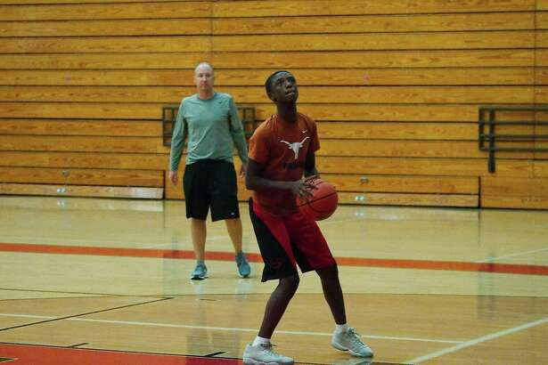 Clear Brook basketball coach Nathan Janak watches as Jakorian Thomas puts up a shot during a shooting drill at the Clear Brook High School summer basketball camp.