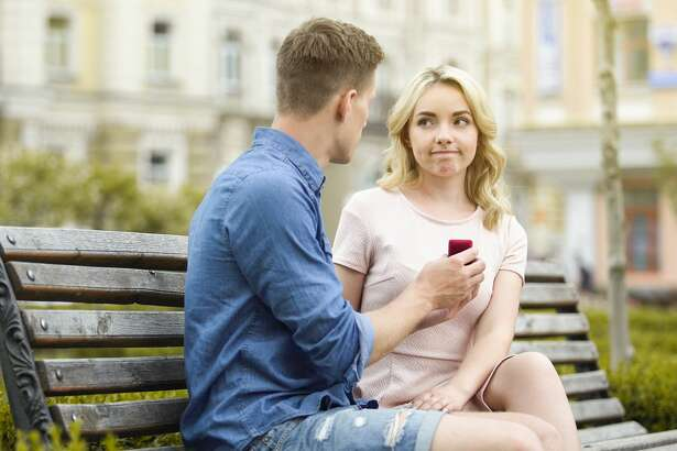 Young woman rejecting boyfriends proposal, disappointed with engagement ring