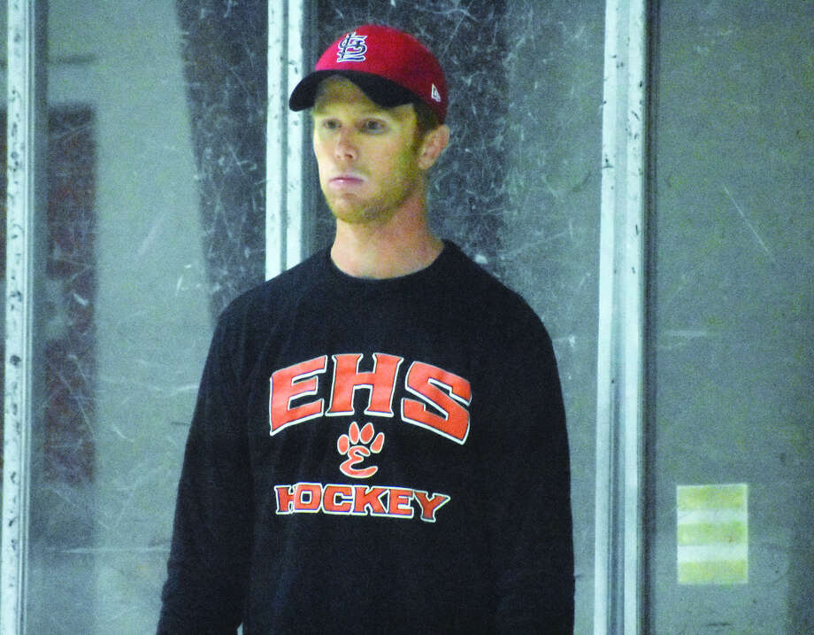 Edwardsville ice hockey coach Jason Walker directs practice on Wednesday inside the East Alton Ice Arena.