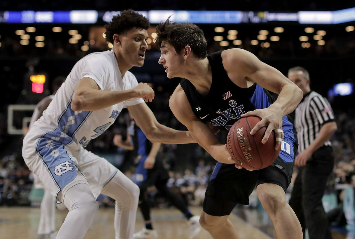 Duke guard Grayson Allen (3) looks to drive against North Carolina forward Justin Jackson (44) in the first half of an NCAA college basketball game during the semifinals of the Atlantic Coast Conference tournament, Friday, March 10, 2017, in New York. (AP Photo/Julie Jacobson)