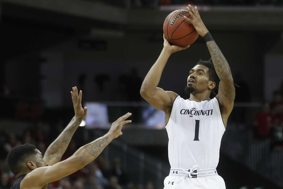 FILE - In this Feb. 6, 2018, file photo, Cincinnati's Jacob Evans (1) shoots in the first half of an NCAA college basketball game against Central Florida, in Highland Heights, Ky. Evans is a possible pick in Thursday's NBA Draft. (AP Photo/John Minchillo, File)
