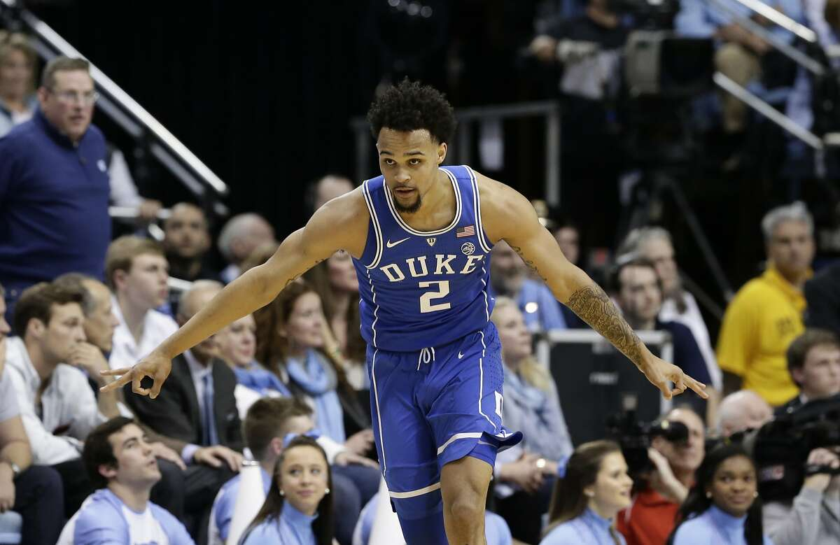 FILE - In this Feb. 8, 2018, file photo, Duke's Gary Trent Jr. (2) reacts following a three-point basket against North Carolina during the first half of an NCAA college basketball game in Chapel Hill, N.C. Trent is a possible pick in Thursday's NBA Draft. (AP Photo/Gerry Broome, FIle)