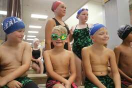 Deer Park Seals swimmers Braxton McKamie (Left) and Weston Barker have League City Barracuda athlete Lincoln Peebles surrounded as the three await in the ready area for the 8-and-under 25-yard breaststroke. Weston captured third place with the time of 33.09. Teammate Dylan Ward was first in 28.05.