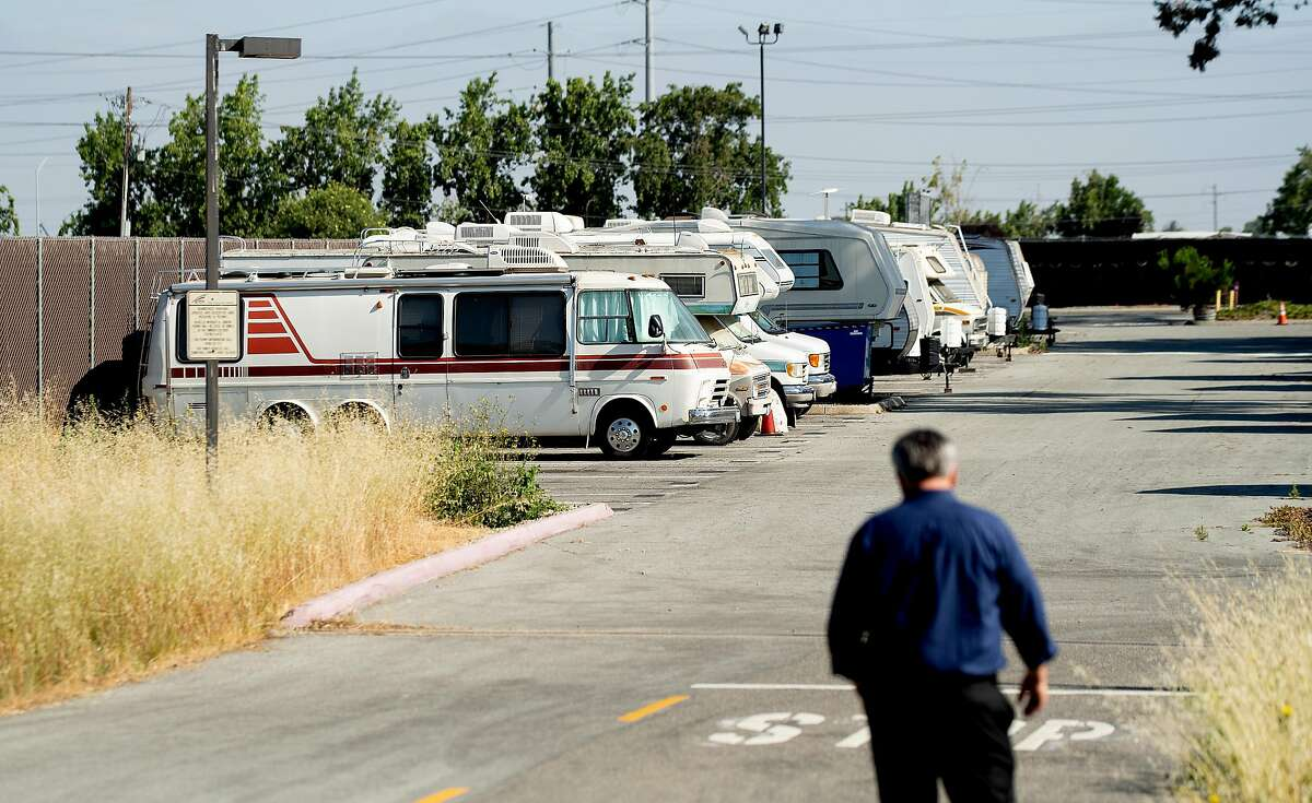 John Courtney, recording and financial secretary for Amalgamated Transit Union Local 265, walks towards recreational vehicles at VTA's Cerone bus yard in San Jose, Calif., on Monday, June 18, 2018. The transit agency permits some workers, who have long commutes, to sleep overnight in the lot.