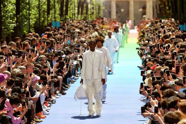 Models present creations by Louis Vuitton fashion house during the men's spring/summer 2019 collection fashion show on June 21, 2018 in Paris.  / AFP PHOTO / BERTRAND GUAYBERTRAND GUAY/AFP/Getty Images