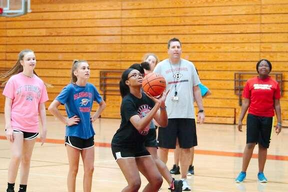 Amanda Benjamin participates in a free throw shooting drill at the Clear Brook summer basketball camp.