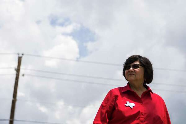 In this photo taken May 22, 2018, gubernatorial candidate and former Dallas County Sheriff Lupe Valdez waits to greet voters outside Renner Frankford Branch Library in Dallas. Valdez owes $12,000-plus in overdue property taxes on seven properties, a previously unreported shortfall that could prove embarrassing as she tries to unseat Republican Greg Abbott in November. The Houston Chronicle reports that Valdez's campaign acknowledges that she owes back property taxes, but is paying them back in installments. (Ashley Landis/The Dallas Morning News via AP)