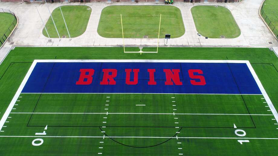Beaumont Independent School District's new artificial turf with the Timberwolves and Bruins labeled in the end zones was unveiled Thursday morning.
