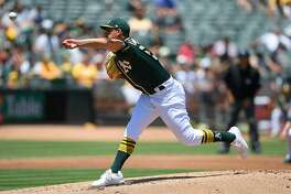 OAKLAND, CA - JUNE 16:  Sean Manaea #55 of the Oakland Athletics pitches against the Los Angeles Angels of Anaheim in the top of the second inning at the Oakland Alameda Coliseum on June 16, 2018 in Oakland, California.  (Photo by Thearon W. Henderson/Getty Images)