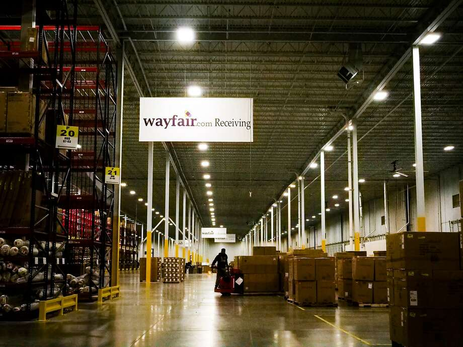 FILE-- A worker inside the Wayfair distribution center in Cranbury, N.J., April 13, 2017. Internet retailers can be required to collect sales taxes in states where they have no physical presence, the Supreme Court ruled on June 21, 2018. State officials in South Dakota sued three online retailers, including Wayfair, for violating a law that required merchants to collect sales tax. (John Taggart/\ The New York Times) Photo: JOHN TAGGART, NYT
