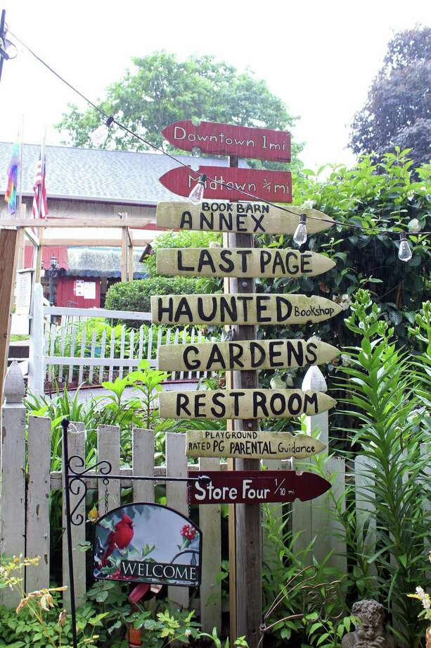 Signs get you headed in the right direction when you arrive at the Book Barn in Niantic. Photo: Genevieve Reilly / Hearst Connecticut Media / Fairfield Citizen