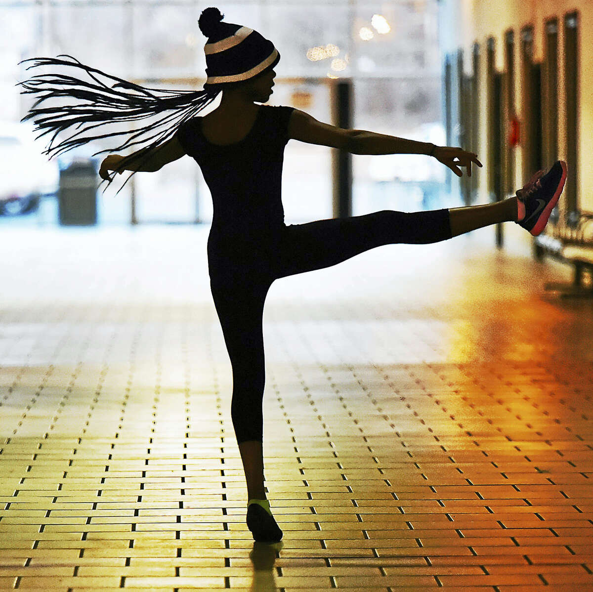 New Haven resident Teriah Brookshire, then 12, a member of the dance team at Elite Sounds of the Arts Academy practices her a la seconde turn for ballet class in 2016, in the hallway at Trolley Square at 1175 State Street in New Haven. Brookshire has been studying jazz, ballet, lyrical and hip hop for five years under director Simone C.Darby. (Catherine Avalone - New Haven Register)