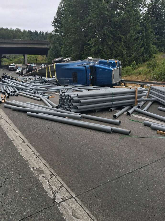 Some freeway interchanges are closed in the Southcenter area after a  semi truck spilled a load of pipes on the southbound Interstate 5 ramp  to northbound Interstate 405 Thursday morning. Photo: State Patrol