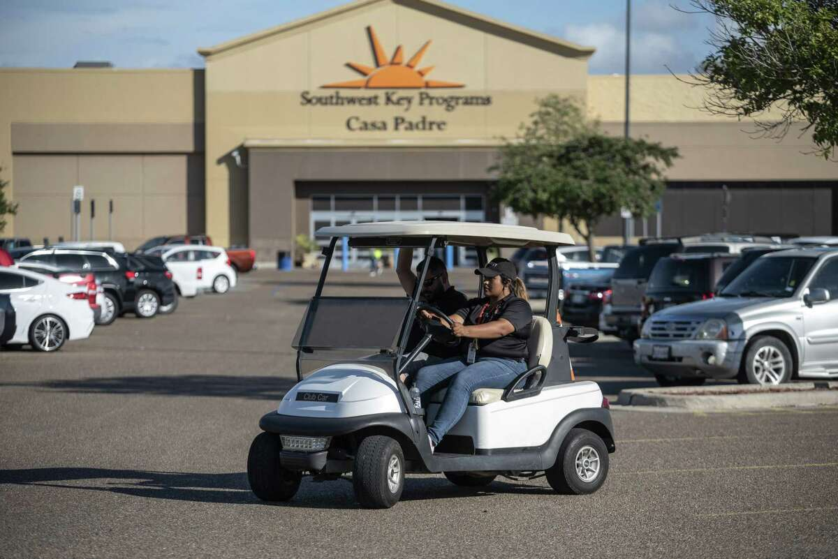 Security guards monitor the perimeter of the Southwest Key Casa Padre facility, formerly a Walmart Inc. store, in Brownsville on Sunday, June 17, 2018. Walmart says they didn't know its former store would be used to house undocumented immigrants who are minors when they sold the property in 2016, though county deed records show that Southwest Key was financing the sale.