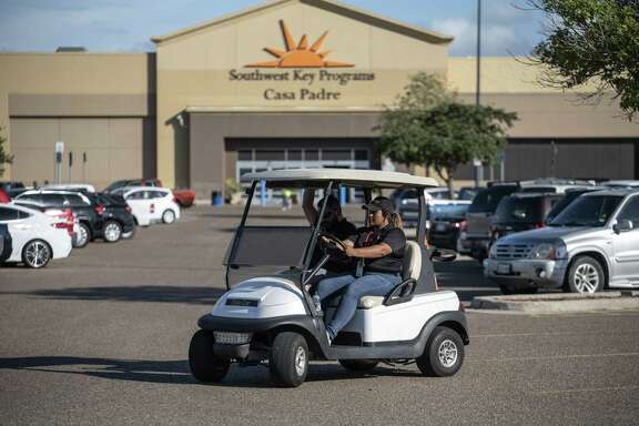 Security guards monitor the perimeter of the Southwest Key-Casa Padre Facility, formerly a Walmart Inc. store, in Brownsville, Texas, U.S., on Sunday, June 17, 2018.