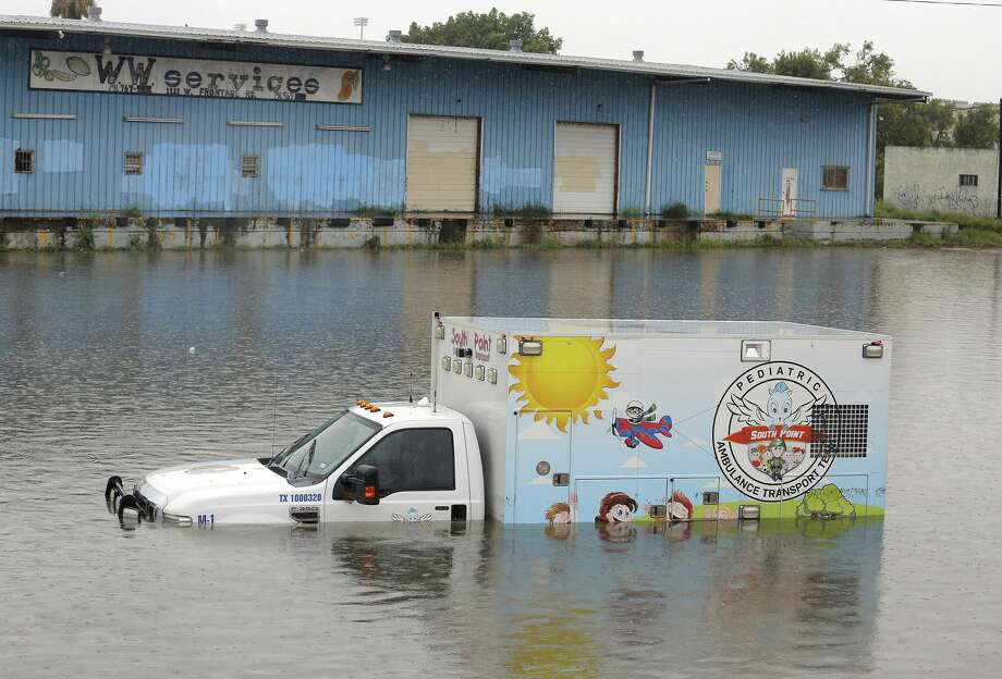 An ambulance sit stalled along the frontage road next to Expressway 83 as heavy rains caused water to rise and flood whole neighborhoods on Wednesday, June 20, 2018, in Weslaco, Texas. (Joel Martinez/The Monitor via AP) Photo: Joel Martinez/Associated Press