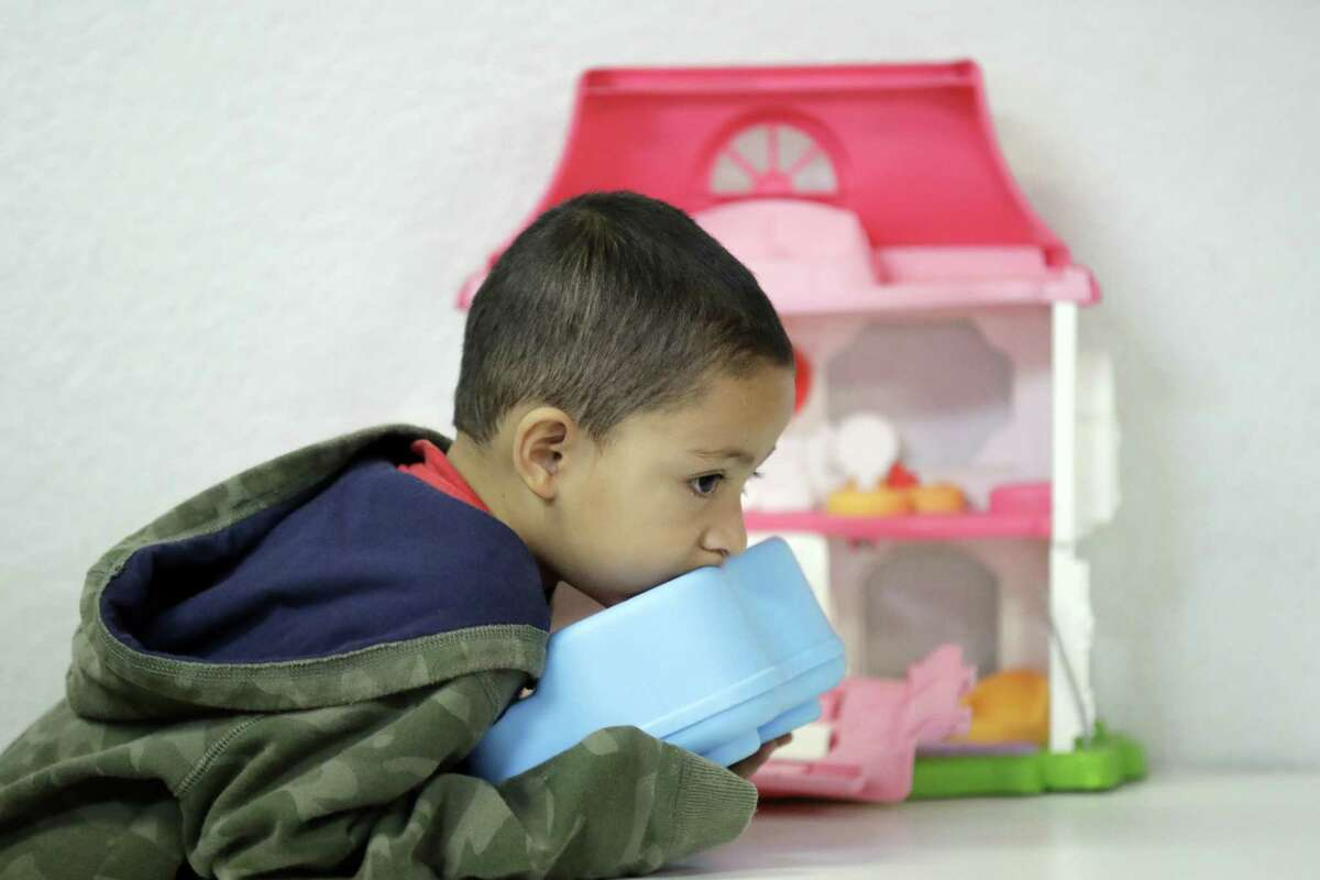 Jensen Torres, 4, an immigrant from Honduras, waits with his family at the Catholic Charities RGV, Thursday, June 21, 2018, in McAllen, Texas. His family was processed and released by U.S. Customs and Border Protection Tuesday and are waiting to travel to New York. (AP Photo/David J. Phillip)