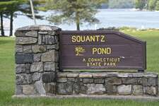 File photo of the sign at the entrance of Squantz Pond State Park, in New Fairfield.