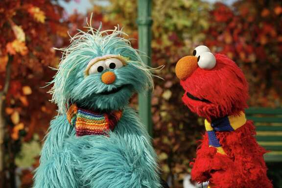 "This photo released by the Sesame Workshop shows Rosita, left, and Elmo. In its first foray into children's programming, Apple announced Wednesday that it has ordered two shows — one live-action, the other animated — from Sesame Workshop, the maker of ""Sesame Street."""