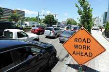 Vehicles sit in gridlock on Washington Blvd., at the intersection of Broad St., due to repaving work around downtown Stamford, Conn. Photographed on Thursday, June 21, 2018.