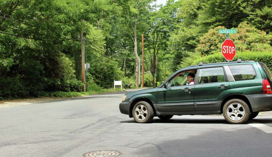 Drivers turning off of Oldfield Road onto Sasco Hill Road must pull out into the intersection to check for oncoming vehicles. The Police Department hopes new stop signs on Sasco Hill at the intersection will improve safety. Fairfield,CT. 6/20/18 Photo: Genevieve Reilly / Hearst Connecticut Media / Fairfield Citizen