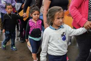 MCALLEN, TEXAS - June 20, 2018: Central American Asylum seekers walk from the McAllen bus station to the Humanitarian Respite Center where they can shower, change into clean clothes and eat after being processed through immigration.