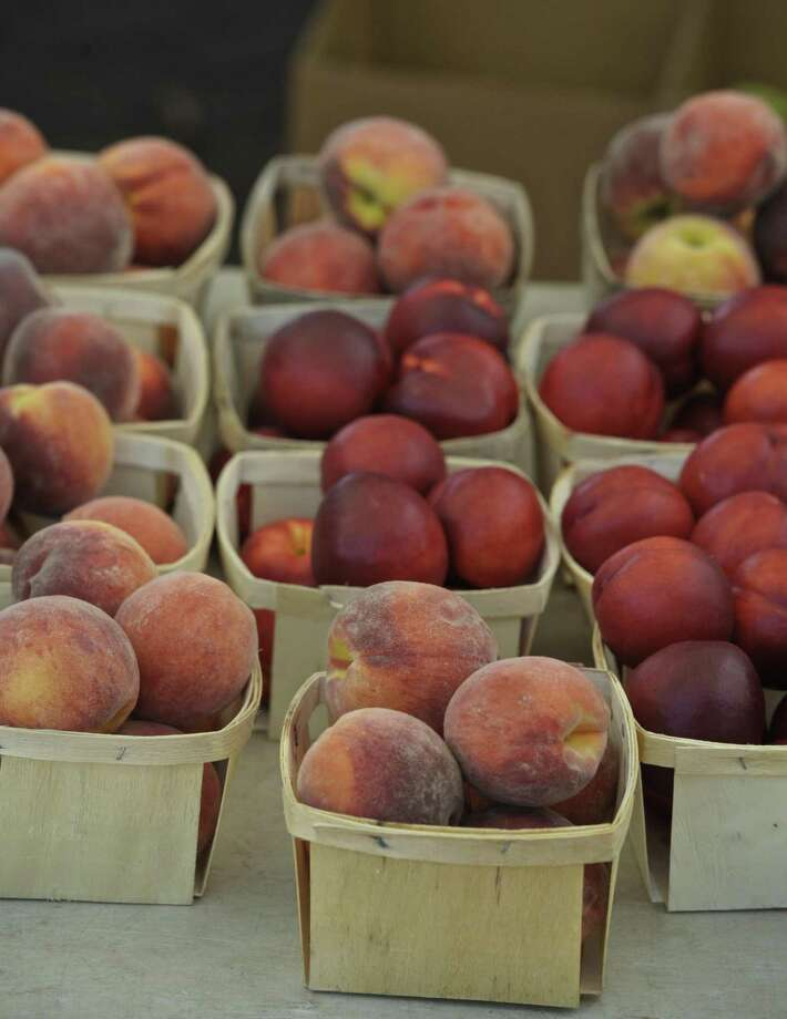 In this file photo, peaches are on display at the Smith's Acres booth at the CityCenter Danbury Farmers Market. Photo: H John Voorhees III / Hearst Connecticut Media / The News-Times