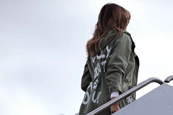 JOINT BASE ANDREWS - JUNE 21:  U.S. first lady Melania Trump boards an Air Force plane before traveling to Texas to visit facilities that house and care for children taken from their parents at the U.S.-Mexico border June 21, 2018 at Joint Base Andrews, Maryland. The first lady is traveling to Texas to see first hand the condition and treatment that children taken from their families at the border were receiving from the federal government. Following public outcry and criticism from members of his own party, President Donald Trump signed an executive order Wednesday to stop the separation of migrant children from their families, a practice the administration employed to deter illegal immigration at the U.S.-Mexico border.  (Photo by Chip Somodevilla/Getty Images)