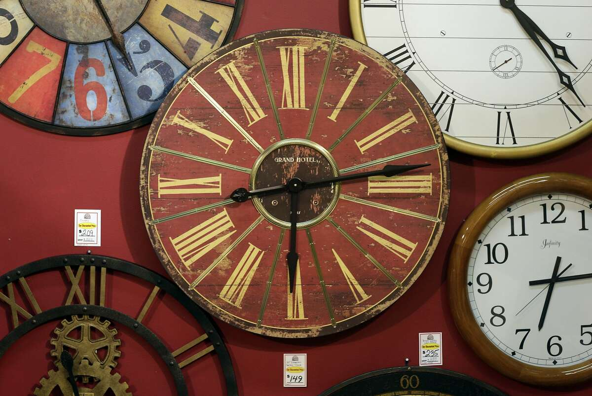 Clocks hang on a wall in Hands of Time, a clock store and repair shop in Savage, Md., Friday, March 8, 2013. It's the weekend to spring ahead for daylight saving time. Officially, the change starts Sunday at 2 a.m., and most Americans will get an hour less sleep but will gain an hour more of evening sunlight in the coming months. Not every place makes the switch. The exceptions are Hawaii, most of Arizona, Puerto Rico, the Virgin Islands, American Samoa, Guam and the Northern Marianas. (AP Photo/Patrick Semansky)