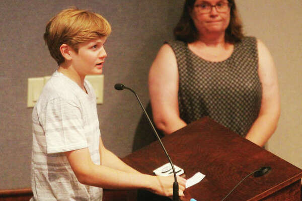 Nick Petrocelli, 13, of Edwardsville, speaks out against a referendum to make Madison County a sanctuary county for lawful gun owners. Behind him is Trish Oberweis, who spoke after him. The County Board voted 15-10 in favor of placing the resolution on the ballot in November.