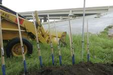 Shovels and an earthmover were set at the intersection of Texas 151 and Loop 410 in 2015 for a groundbreaking ceremony to construct flyover traffic ramps at the congested intersection.