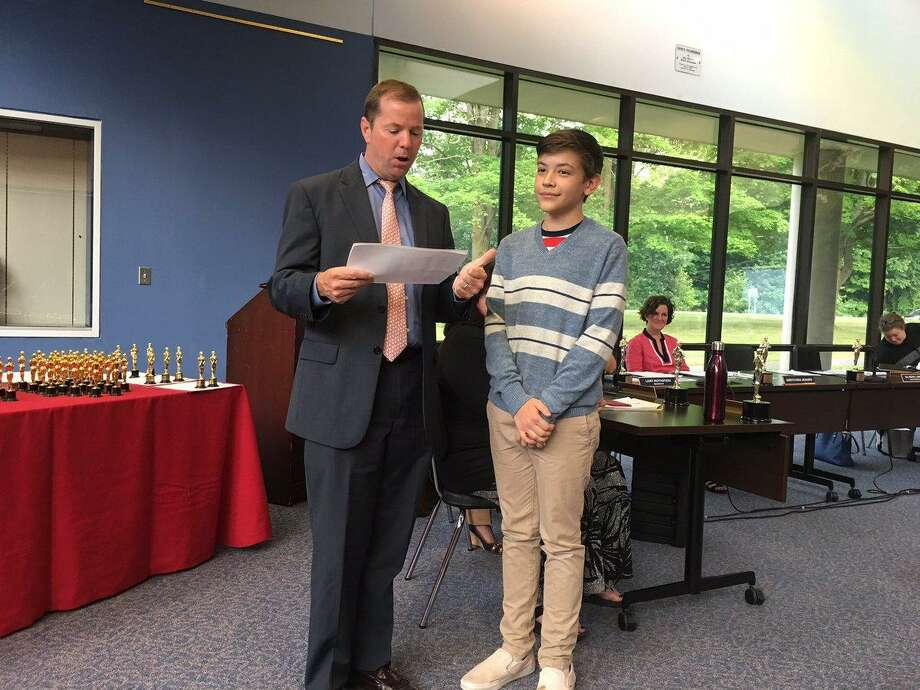 Wilton Superintendent Kevin Smith awards Harrison Forland on John M. Repicky Award, the top prize awarded by the Area 9 Cable Council as a part of the 15th annual Educational Access Awareness Awards, on Wednesday, June 20, 2018. Photo: Contributed Photo