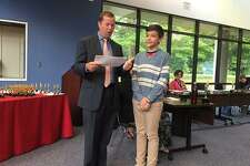 Wilton Superintendent Kevin Smith awards Harrison Forland on John M. Repicky Award, the top prize awarded by the Area 9 Cable Council as a part of the 15th annual Educational Access Awareness Awards, on Wednesday, June 20, 2018.