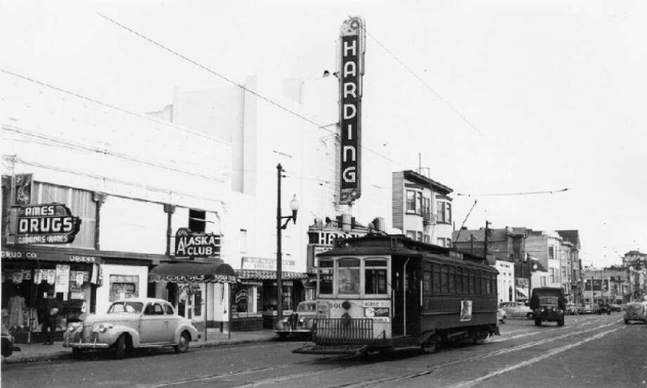 Divisadero near Grove Muni 32-line passes by the Harding Theatre in 1948. Photo: OpenSF History