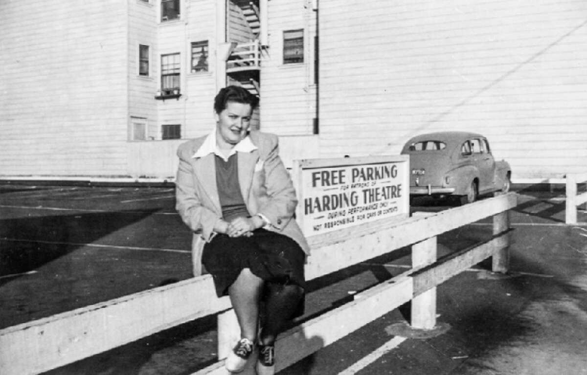 Divisadero near Hayes A woman poses in the parking lot of the Harding Theatre in June 1941.