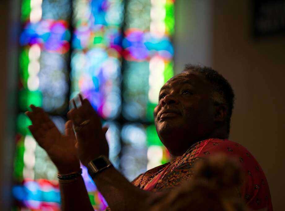 A worshiper at Glide Memorial Church, which is facing controversy. Photo: D. Ross Cameron / Special To The Chronicle 2017