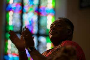 An unidentified parishioner claps along to the music at a service where Karen Hanrahan was introduced as the new president and CEO of Glide Memorial Church, on Sunday, Aug. 27, 2017 in San Francisco, Calif. (D. Ross Cameron / Special to The Chronicle)