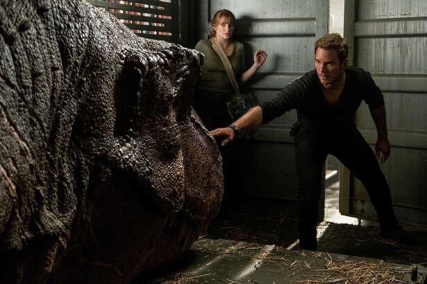 "Claire (Bryce Dallas Howard) and Owen (Chris Pratt) try not to wake a T. rex in ""Jurassic World: Fallen Kingdom."""
