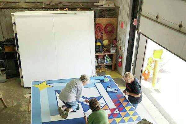 It takes a couple of days and several volunteers to draw out and paint an 8-by-8 feet plywood quilt block. Among those who helped with Cass City Village's quilt block were Dottie Scollon, Nancy Barrios, and Marlene Donaldson. (Submitted Photo)