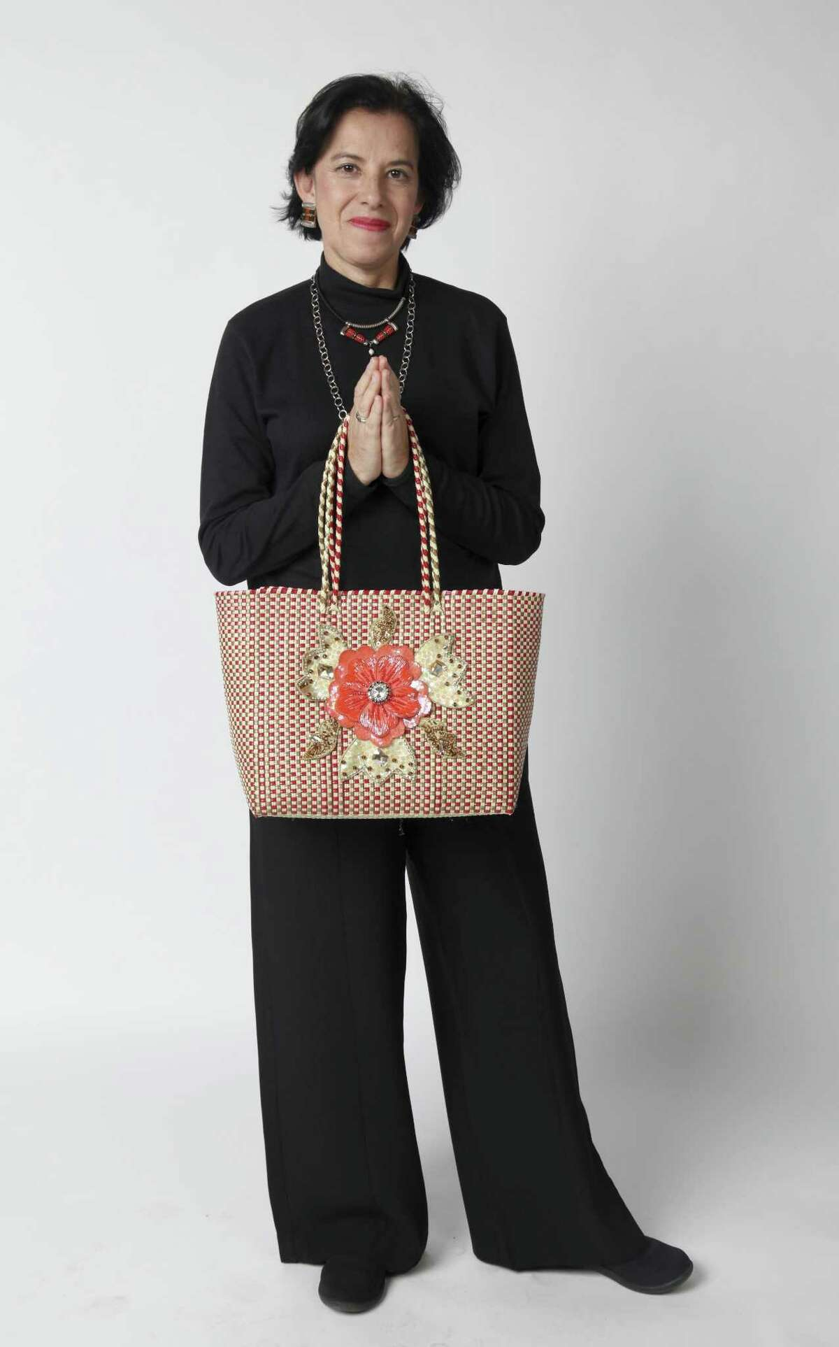 Veronica Prida's bag, her own design, is a large handwoven colorful Mexican market bag that one would fill with groceries.