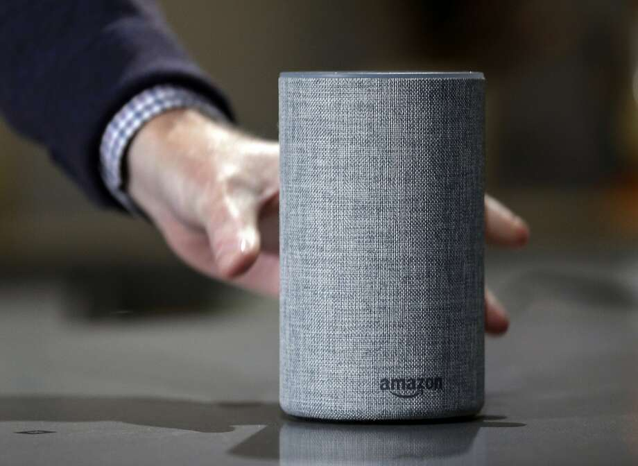 FILE - In this Sept. 27, 2017, file photo, a new Amazon Echo is displayed during a program announcing several new Amazon products by the company, in Seattle. Amazon has launched a version of Alexa for hotels that lets guests order room service through the voice assistant, ask for more towels or get restaurant recommendations without having to pick up the phone and call the front desk. Marriott signed up for the service. (AP Photo/Elaine Thompson, File) Photo: Elaine Thompson, Associated Press