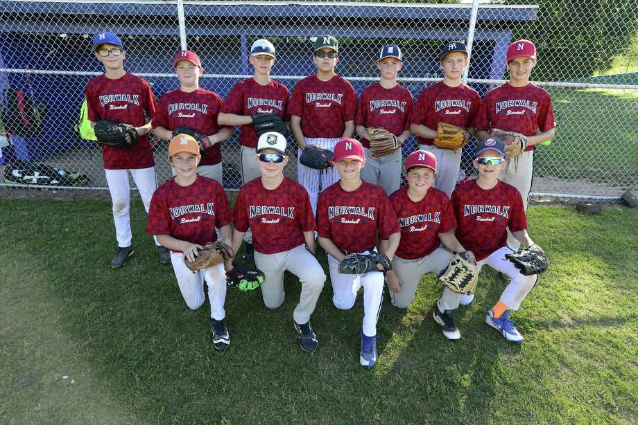 Norwalk's Little League 12-year-old All-Stars pose for a team photo before practicing for this year's District 1 tournament at Broad River Field in Norwalk on Tuesday. Photo: Matthew Brown / Hearst Connecticut Media / Stamford Advocate