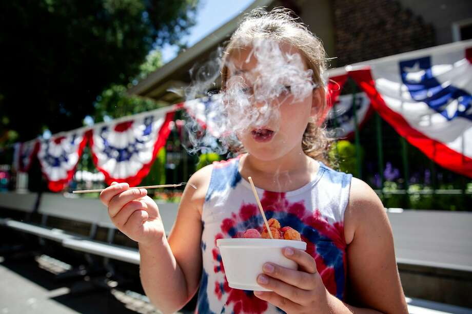Adalyn Hofmann, 8, eats a bowl of Nitro Puffs from the Nitro Shack at the Alameda County Fair on Thursday. Nitrogen-infused cereal balls are a new cold treat at the fair this year. Photo: Brittany Hosea-Small / Special To The Chronicle