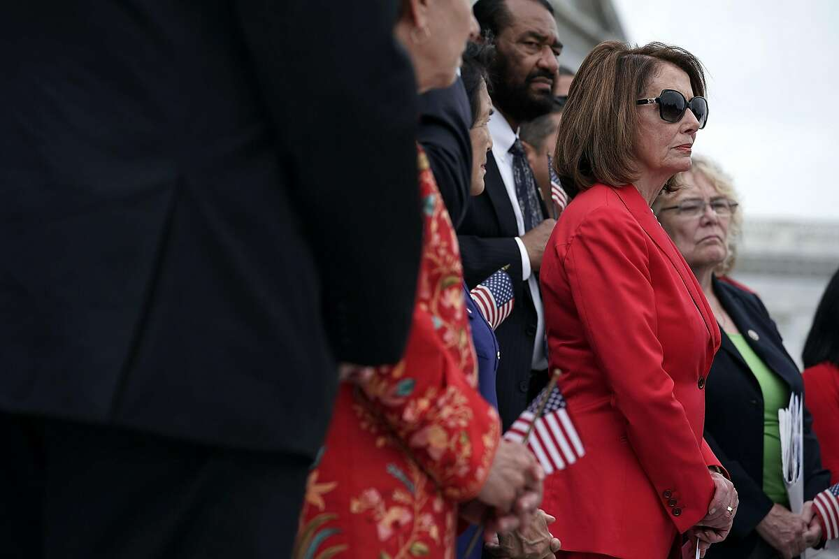 """WASHINGTON, DC - JUNE 20: U.S. House Minority Leader Rep. Nancy Pelosi (D-CA) and other House Democrats listen during a news conference in front of the U.S. Capitol June 20, 2108 in Washington, DC. House Democrats held a news conference to discuss H.R.6135, """"The Keep Families Together Act."""" (Photo by Alex Wong/Getty Images)"""