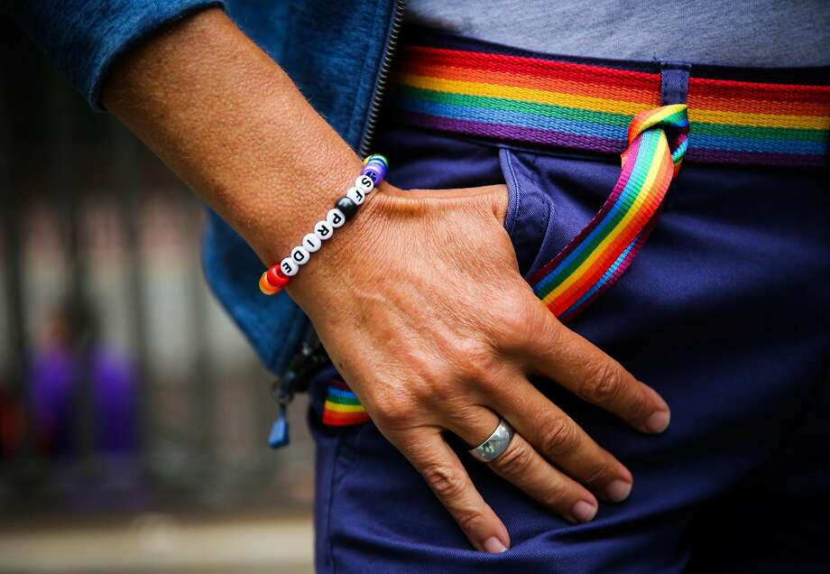 Sandra Heer shows off her bracelet during the Pride Parade in San Francisco, California, on Sunday, June 25, 2017. Photo: Clockwise From Top Left, Gabrielle Lurie / The Chronicle 2017, Gabrielle Lurie / The Chronicle 2017, Nicole Boliaux / The Chron