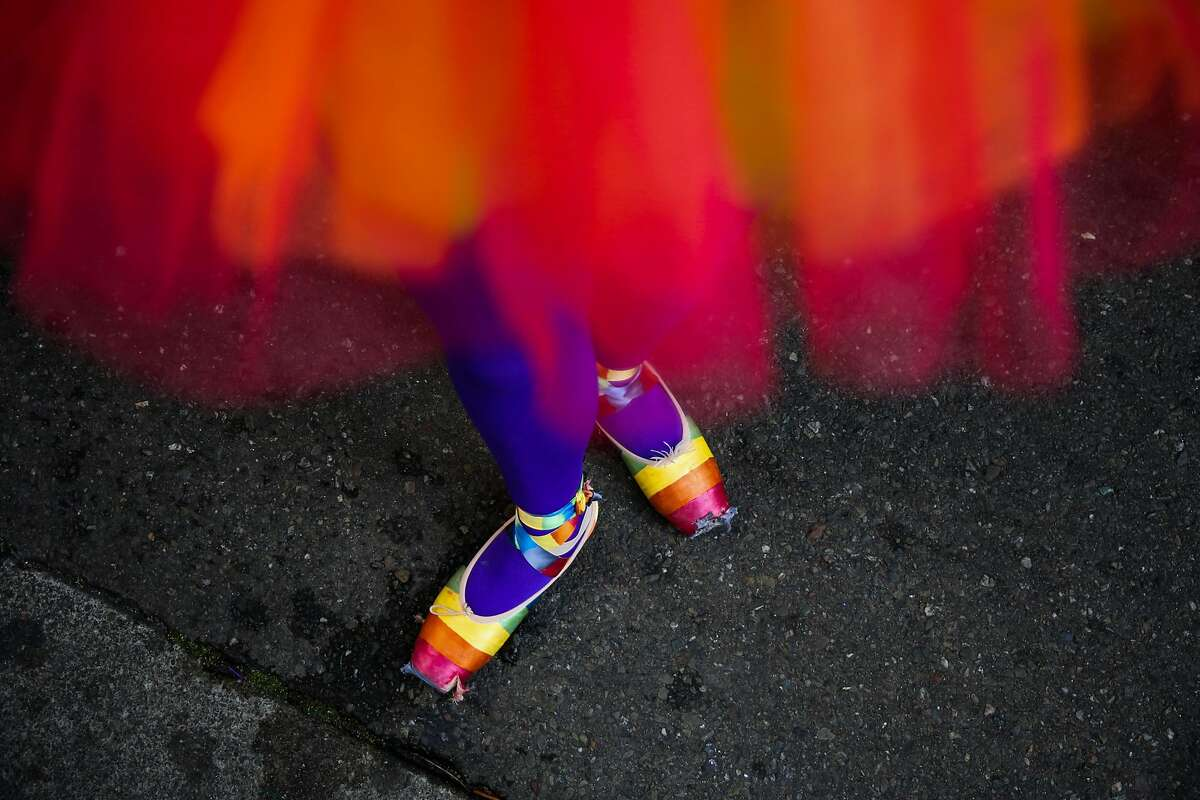 Sophia Fox-Mount, 13, shows off her colorful ballet flats ahead of the Oakland Pride Parade in Oakland, Calif., on Sunday, Sept. 10, 2017.
