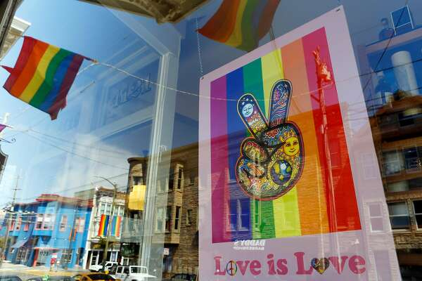 A Love is Love sign as seen through the Castro Village Wine Co. on the corner of 19th and Castro Streets on Tuesday, June 19, 2018 in San Francisco, Calif.