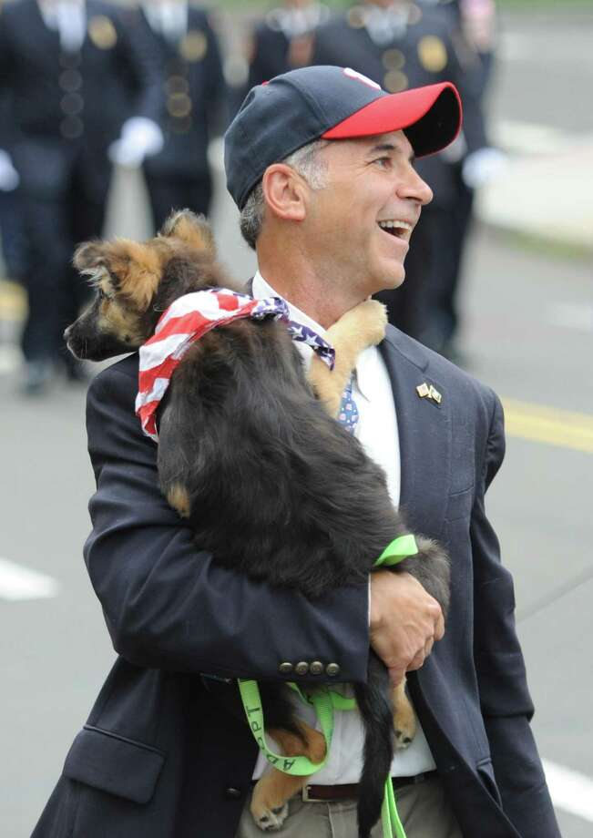State Rep. Fred Camillo and his dog, Reagan, march in the Ninth District Veterans Association and the Glenville Volunteer Fire Company's annual Glenville Parade and Memorial Service in the Glenville section of Greenwich, Conn. Sunday, May 27, 2018. Photo: Tyler Sizemore / Hearst Connecticut Media / Greenwich Time