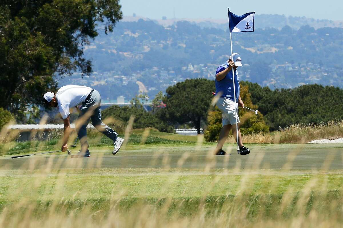 Golfers at the Corica Park South Course, Wednesday, June 20, 2018, in Alameda.
